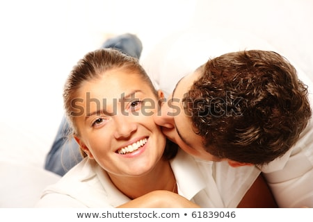 Kiss over white, young passion couple stock photo © lunamarina