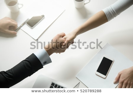 handshake between man and woman Stock photo © Nelosa