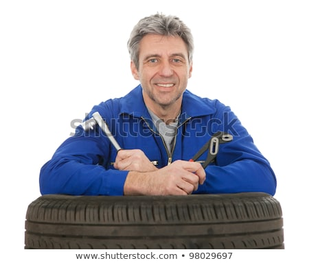Automechanic leaning on car tires Stock photo © AndreyPopov