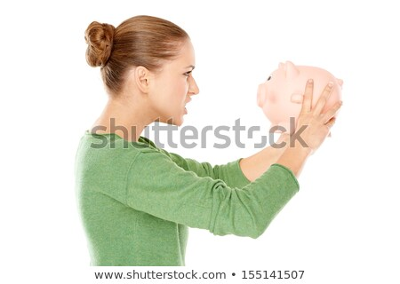 Angry woman arguing with her piggy bank Stock photo © dash