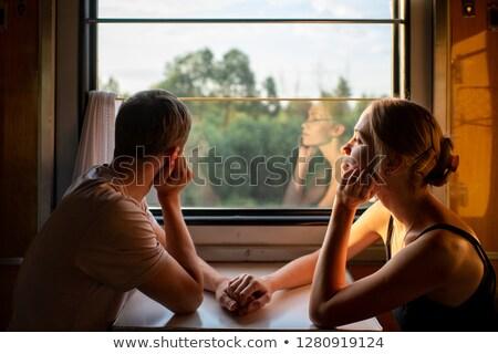 vrouw · trein · naar · peinzend · venster · glimlachend - stockfoto © candyboxphoto