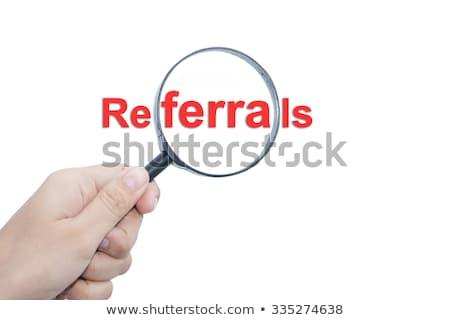 Referral Marketing Concept Through Magnifying Glass. Stock photo © tashatuvango