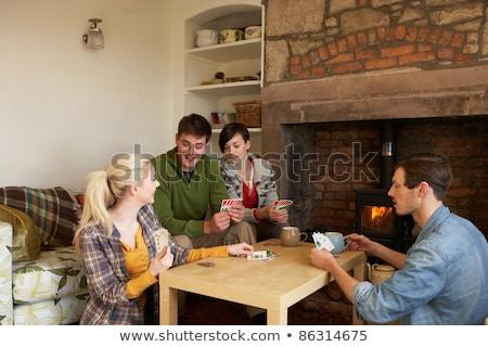 Fiatal párok kényelmes kunyhó ház tűz Stock fotó © monkey_business