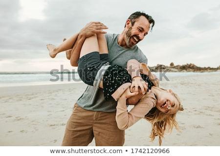 Pai filha de cabeça para baixo ao ar livre menina Foto stock © monkey_business