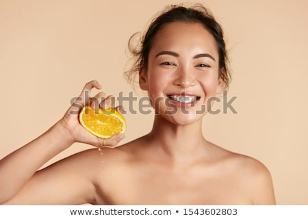 Stockfoto: Beautiful Girl With Juicy Orange