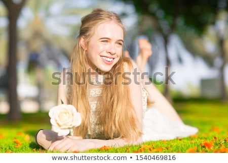 beautiful girl at the park daydreaming stock photo © hasloo
