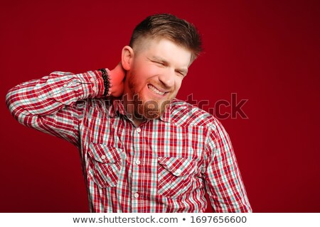fashion man holding the back of his neck stock photo © feedough