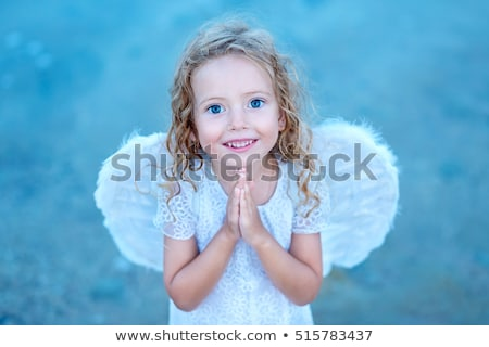 Little angel girl praying Stock photo © ilona75