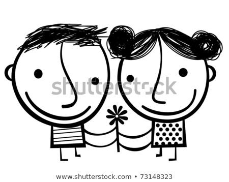 Little girl holding a couple of daisys Stock photo © gemenacom