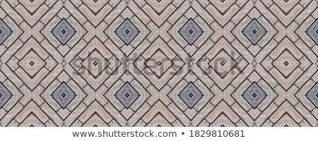 openwork gray pavement slabs stock photo © tashatuvango