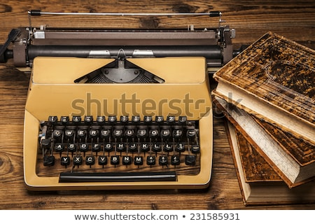 old typewriter a pile of books and a lot of creativity stock photo © brunoweltmann