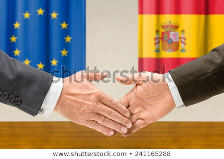 Representatives of the EU and Spain shake hands Stock photo © Zerbor