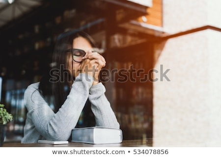 Young girl reading prayer book stock photo © BigKnell