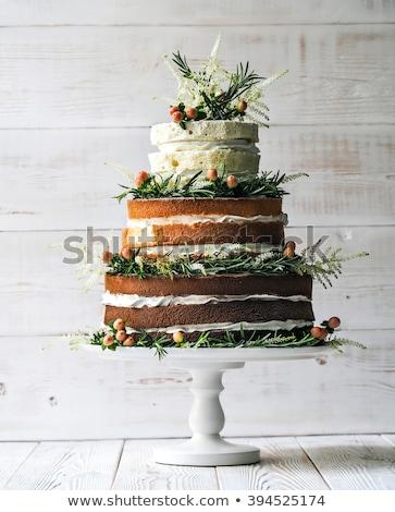 édes ifjú pár esküvői torta pár csók szeretet Stock fotó © user_8545756