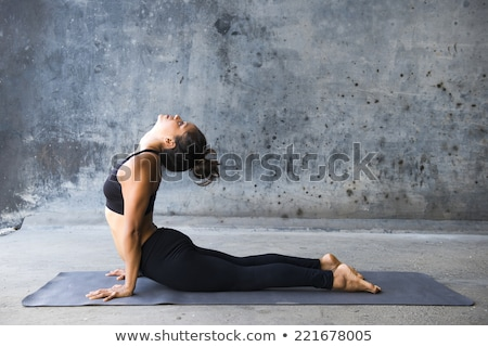 woman in the cobra yoga pose stock photo © hasloo