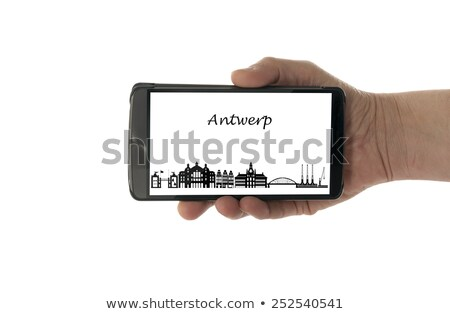 female hand with mobile phone Antwerp skyline Stock photo © compuinfoto