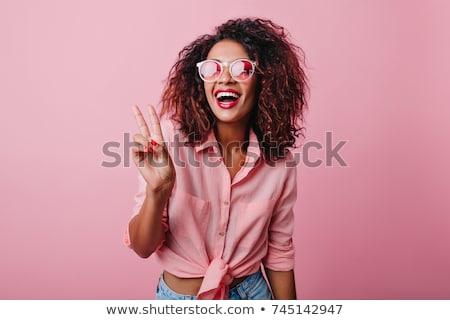 Closeup portrait of a happy fashionable woman Stock photo © deandrobot