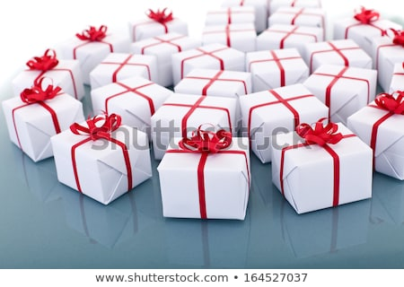 Lots of christmas presents on reflective surface Stock photo © lightkeeper