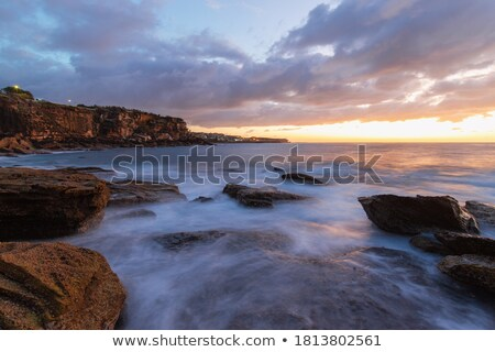 sunrise at coogee australia stock photo © lovleah