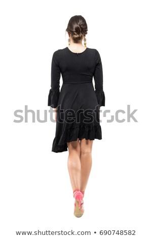 young elegant ashion woman walking on studio background stock photo © feedough