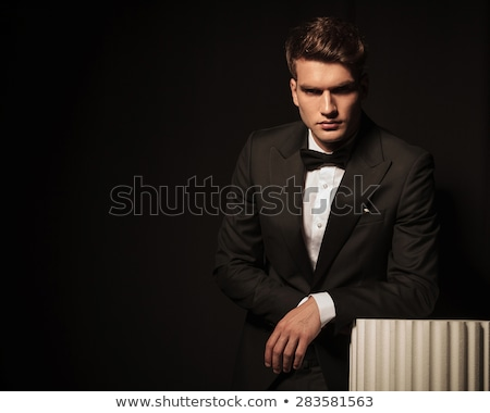 business man leaning his hand on a white column. Stock photo © feedough