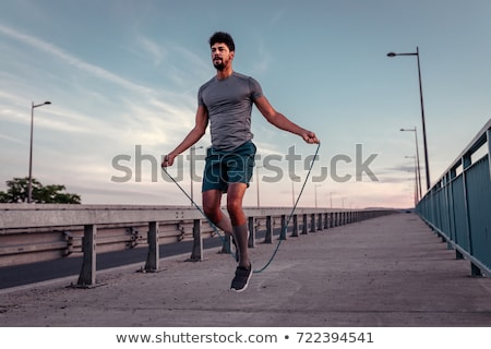 Handsome man with skipping rope Stock photo © deandrobot