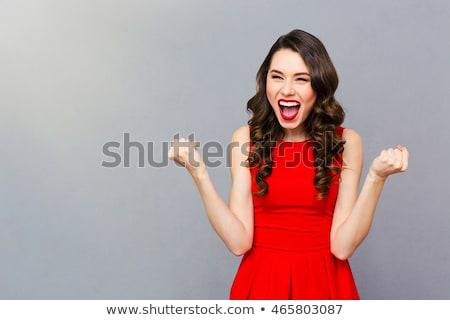 gelukkig · vrouw · vieren · overwinning · armen · omhoog - stockfoto © deandrobot