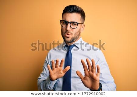 üzletember kifejez tagadás csalódott nyitva kéz Stock fotó © stokkete
