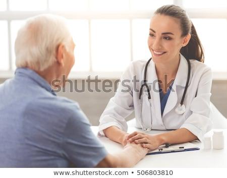 sorridente · médico · sessão · secretária · escritório · mulher - foto stock © wavebreak_media