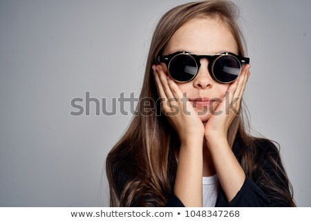 Portrait of girl in black sunglasses holding banana Stock photo © deandrobot