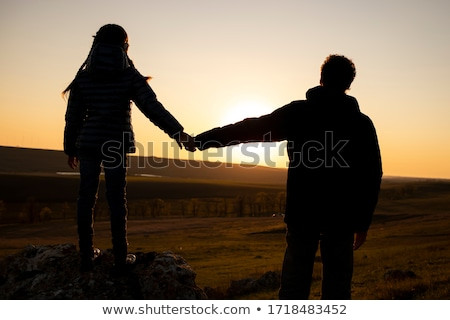 child, who holds for the hands of parents against the background of the sky Stock photo © Paha_L