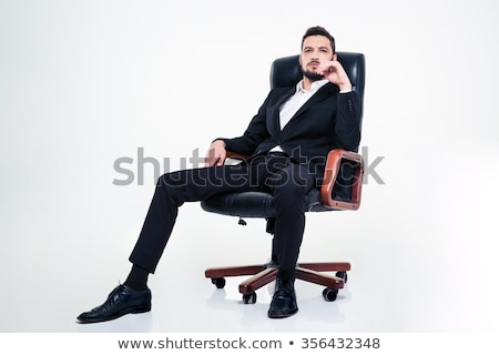 Attractive confident young bearded businessman sitting in  office chair Stock photo © deandrobot