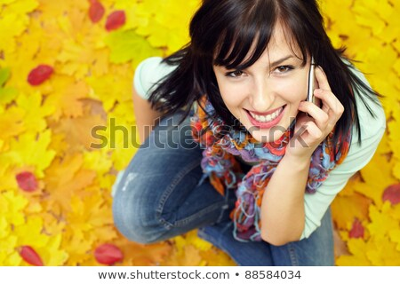 Smiling lovely cute young woman talking on mobile phone  Stock photo © deandrobot