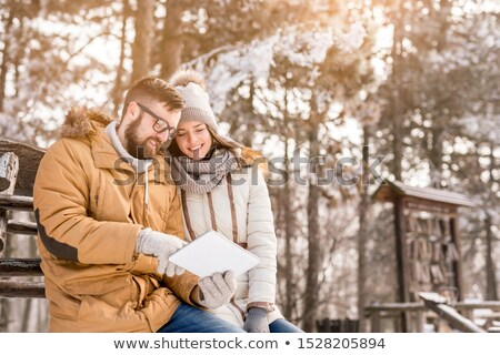 Couple standing and making selfie in snowy weather  Stock photo © deandrobot