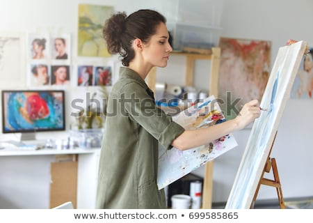 Woman artist making sketches in workshop  Stock photo © deandrobot