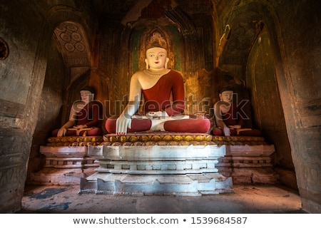 buddha statue inside of temple at bagan stock photo © mikko