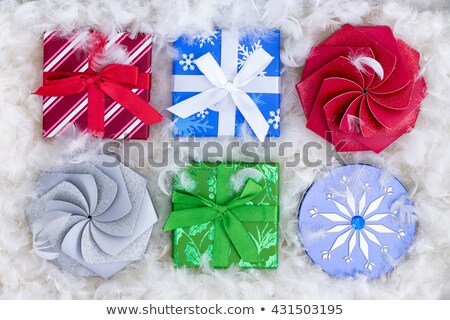 Six Christmas gift boxes in fluffy padding Stock photo © ozgur