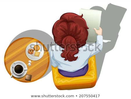 A topview of a woman reading beside the table Stock photo © bluering