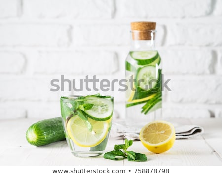 Infused water with citrus and mint in glass bottles Stock photo © vlad_star