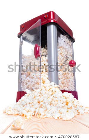 Open door popcorn popper with food pouring out Stock photo © ozgur