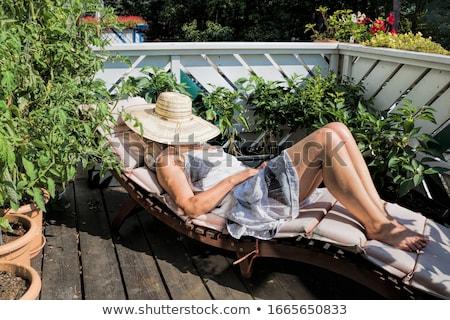 женщину солнечные ванны палуба Председатель довольно Сток-фото © dash
