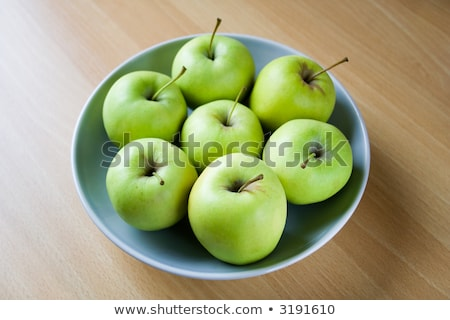 Bunch of green apples in a bowl. Stock photo © lithian