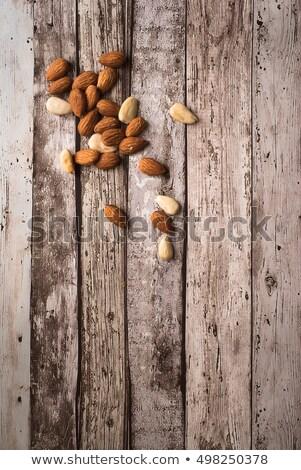 Mandulák rusztikus fából készült felülnézet űr ír Stock fotó © faustalavagna