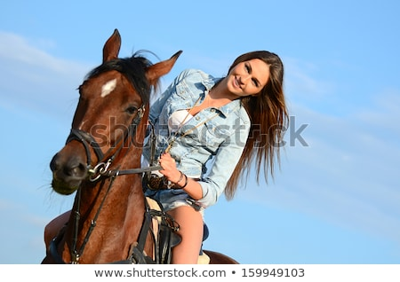Pretty lady riding a horse by gallop Stock photo © konradbak