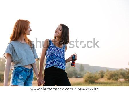 две женщины ходьбе питьевой соды улице два Сток-фото © deandrobot