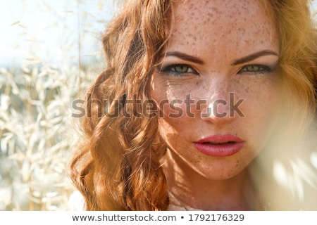 Attractive red-haired woman in dress Stock photo © Aikon