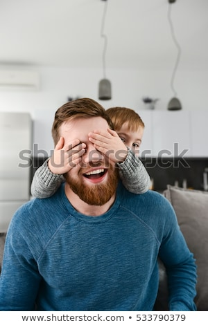 Happy father playing with cute son who covering his eyes Stock photo © deandrobot