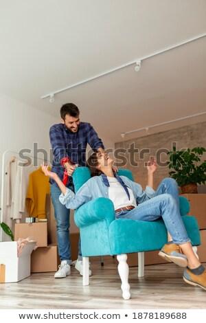 Fiatal pér elvesz törik új otthon ül padló Stock fotó © dash