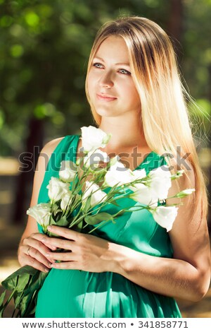 portrait of a blonde pregnant woman with flowers in their hands Stock photo © Yatsenko
