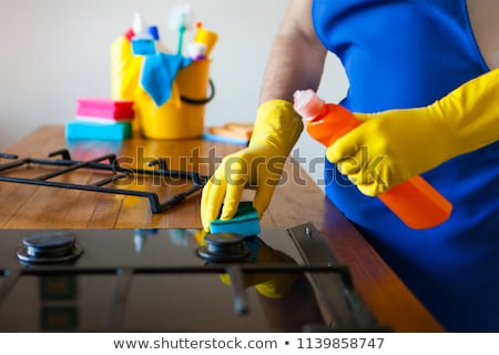 young men in rubber protective cleaning and polish cooker black stock photo © yatsenko